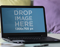 Wide image with laptop at home