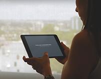 iPad mini held by woman at window