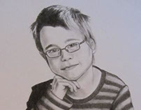 boy in charcoal portrait commission