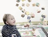 Baby with alphabet blocks