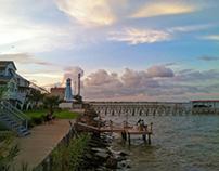 Lighthouse along shoreline on Kemah boardwalk