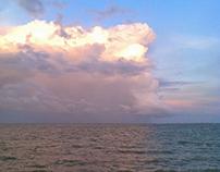 Colorful clouds along horizon shoreline