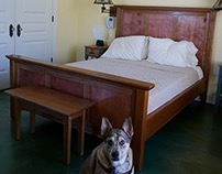 Queen-sized bed with cherry and stained maple panels