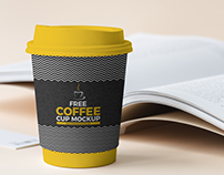 Free Coffee Cup Beside Book Mockup 2018