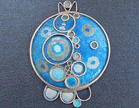 Vintage enamel and silver pendant by Norman Grant