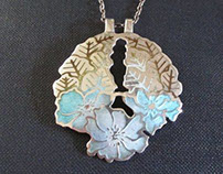 Norman Grant flower pendant necklace silver and enamel