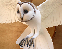 Paper and wood owl sculpture