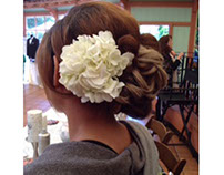 Sweet side bun with peony flower, bridal updo hairstyle