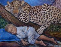 El leopardo durmiendo junto al niño pequeño