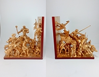 A pair of gold toy bookends