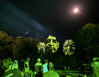 Blink Twice: 3D motion faces projected on trees.