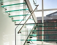 Buttery Contemporary Steel and Glass Staircase