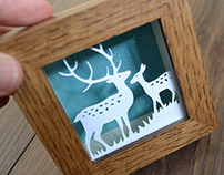 Reindeer miniature paper cut