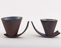 Swinging clay cups