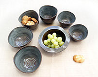 Dark funny bowls with spiral ornament
