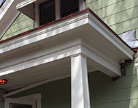 Reconstruction: 1920's craftsman porch and tin roof.