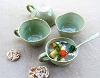 Green soup bowls with handle and curved edge