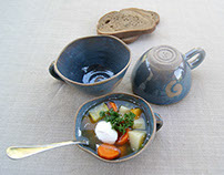Blue soup bowls with handle and curved edge