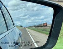 Train in Side View Mirror in Nebraska