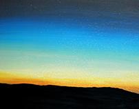 Mountain sunset with stars