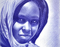 African girl with ballpoint pen by me
