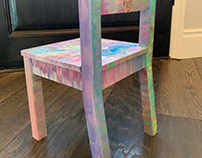 Painting swirls & sparkles on children's chairs