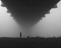 Woman and  dog in the fog