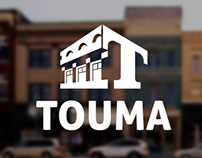 Touma Real Estate Holdings | Logo