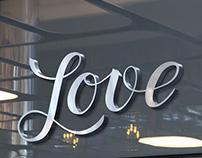 "Handlettering logotype ""LOVE""."