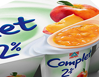 Complet strained yogurt with fruit pieces