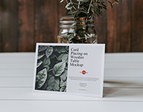 Free Card Placing on Wooden Table Mockup