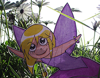 paper fairies in the garden
