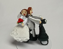 Wedding cake topper with quilled bride and groom