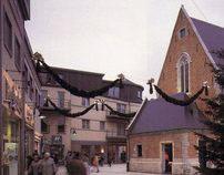 Pieter Van Aelst winkelcentrum en restauratie kapel