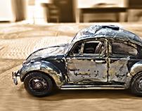 giving new identity to small car (handmade mixed media)