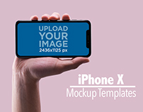 Male Hand Holding an iPhone X Mockup Horizontally