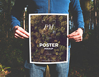 Free Man Holding Poster Mockup PSD