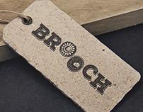 Brooch Clothes Logo