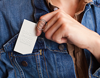 Woman Placing a Business Card in her Jacket's Pocket
