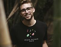 Free Boy Wearing Black T-Shirt Mockup