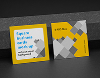 Square business cards mock-up on black paper background