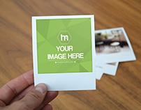 Holding Polaroid Image Mockup
