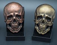 Human skull relief. Faux metal