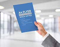 Free A4 Paper In Male Hand Mockup PSD