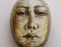 Face on stone