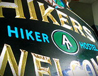 Hikers Welcome carved & gilded road sign