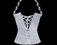 bag with shape of a corset .The handle of the  crystall