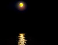 Yellow / Blue moon over Lake Michigan