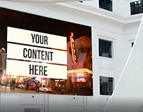 Billboard video mockup inside a white modern building