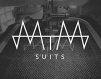 MTM Suits Logo